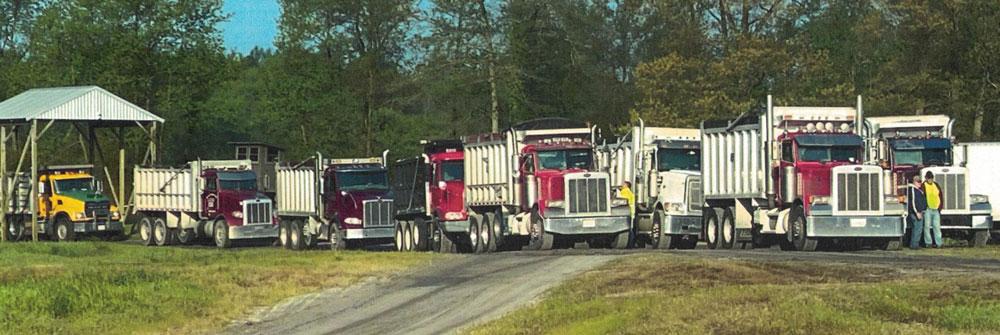 dump trucks in line